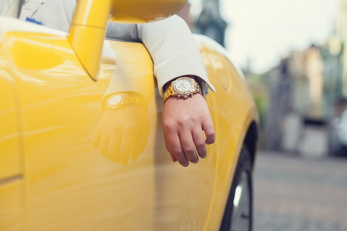 Wealthy man's watch in Porsche