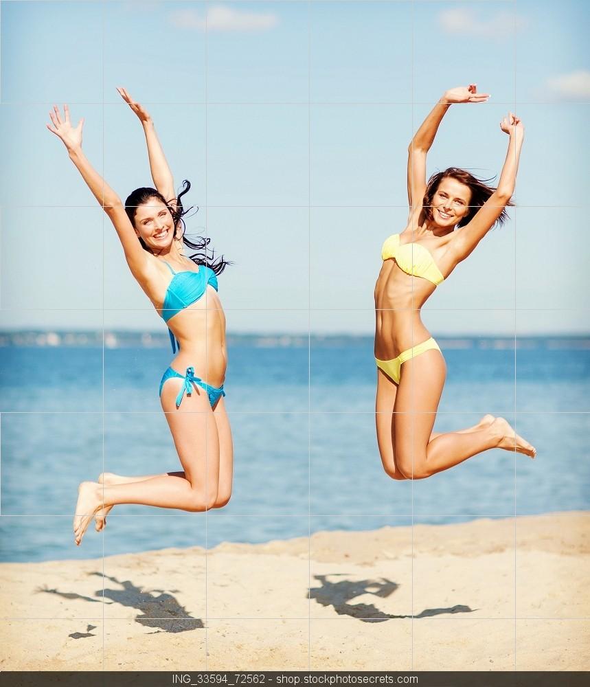 2 girls in bikinis jumping for joy